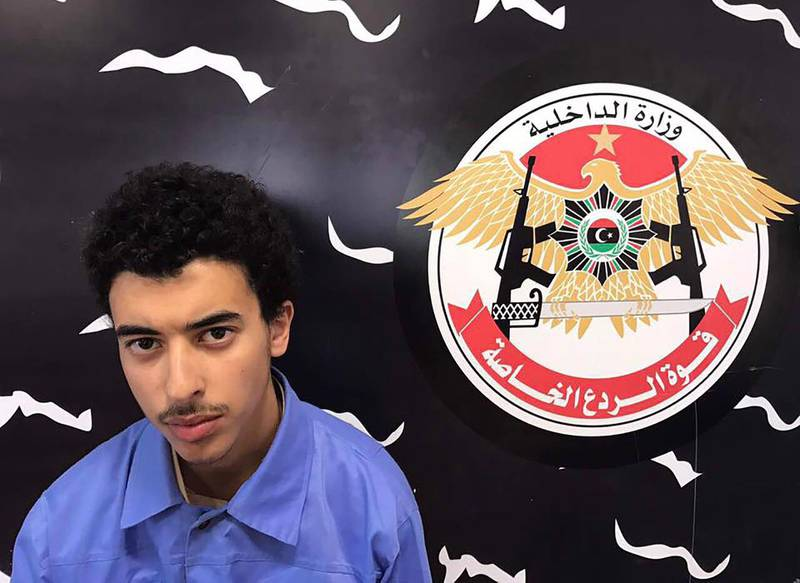 """A photo released on the Facebook page of Libya's Ministry of Interior's Special Deterrence Force on May 24, 2017 claims to shows Hashem Abedi, the brother of the man suspected of carrying out the bombing in the British city of Manchester, after he was detained in Tripoli for alleged links to the Islamic State (IS) group.Libya arrested a brother and father of Salman Abedi who is suspected of the bombing at a pop concert killing 22 people, including children on May 22, 2017. / AFP PHOTO / LIBYA'S SPECIAL DETERRENCE FORCE / HO / RESTRICTED TO EDITORIAL USE - MANDATORY CREDIT """"AFP PHOTO / LIBYA'S SPECIAL DETERRENCE FORCE"""" - NO MARKETING NO ADVERTISING CAMPAIGNS - DISTRIBUTED AS A SERVICE TO CLIENTS"""