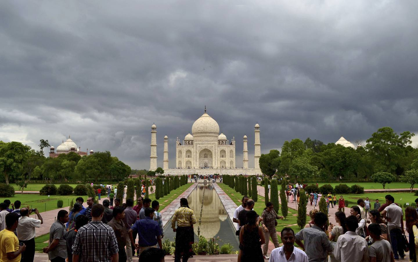 FILE- In this July 21, 2012 file photo, monsoon clouds hover over the Taj Mahal in Agra, India. India's famed monument of love, the white marble Taj Mahal, is finding itself at the heart of a political storm with some members of India's ruling Hindu right-wing party claiming that the mausoleum built by a Muslim emperor does not reflect Indian culture. (AP Photo/Pawan Sharma, File)