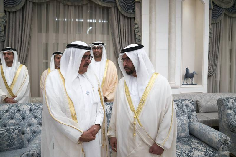 ABU DHABI, UNITED ARAB EMIRATES - August 21, 2018: HH Sheikh Hamdan bin Rashid Al Maktoum, Deputy Ruler of Dubai and UAE Minister of Finance (L) and HH Sheikh Hamdan bin Zayed Al Nahyan, Ruler's Representative in Al Dhafra Region (R) attend an Eid Al Adha reception at Mushrif Palace.  ( Mohamed Al Hammadi / Crown Prince Court - Abu Dhabi ) ---