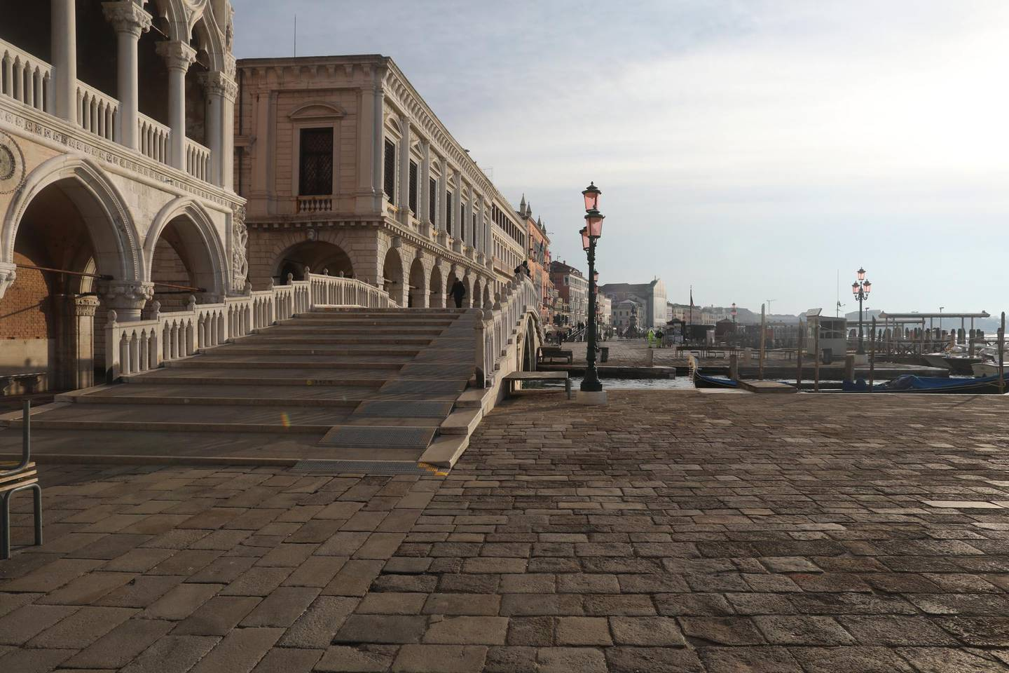 """VENICE, ITALY - MARCH 9: A completely empty Riva degli Schiavoni next to San Marco Square is seen on March 9, 2020 in Venice, Italy. Prime Minister Giuseppe Conte announced a """"national emergency"""" due to the coronavirus outbreak and imposed quarantines on the Lombardy and Veneto regions, which contain roughly a quarter of the country's population. Italy has the highest number of cases and fatalities in Europe.  The movements in and out are allowed only for work reasons, health reasons proven by a medical certificate.The justifications for the movements needs to be certified with a self-declaration by filling in forms provided by the police forces in charge of the checks. (Photo by Marco Di Lauro/Getty Images)"""