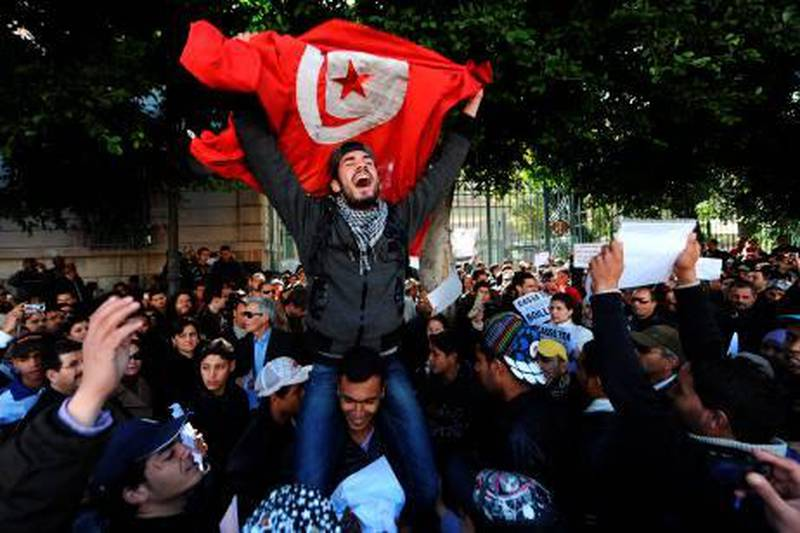 """Tunisians protest outside the gates to the French embassy in Tunis for remarks made by French ambassador Boris Boillon on his arrival and calling for his departure on February 19, 2011. While calling for a """"new page"""" in relations between France and Tunisia, Boillon, 41, refused to take questions from some journalists at a press conference yesterday and dismissed others as """"stupid."""" Extracts from the encounter were broadcast on Tunisian television and sparked a Facebook page calling for Boillon to go.   AFP PHOTO / FETHI BELAID"""