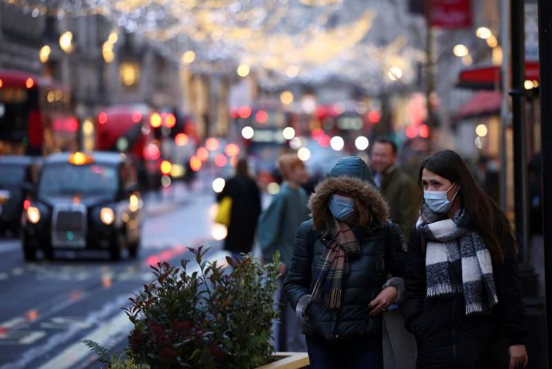 People walk along Regent Street, amid the coronavirus disease (COVID-19) outbreak, in London, Britain, December 14, 2020. REUTERS/Henry Nicholls