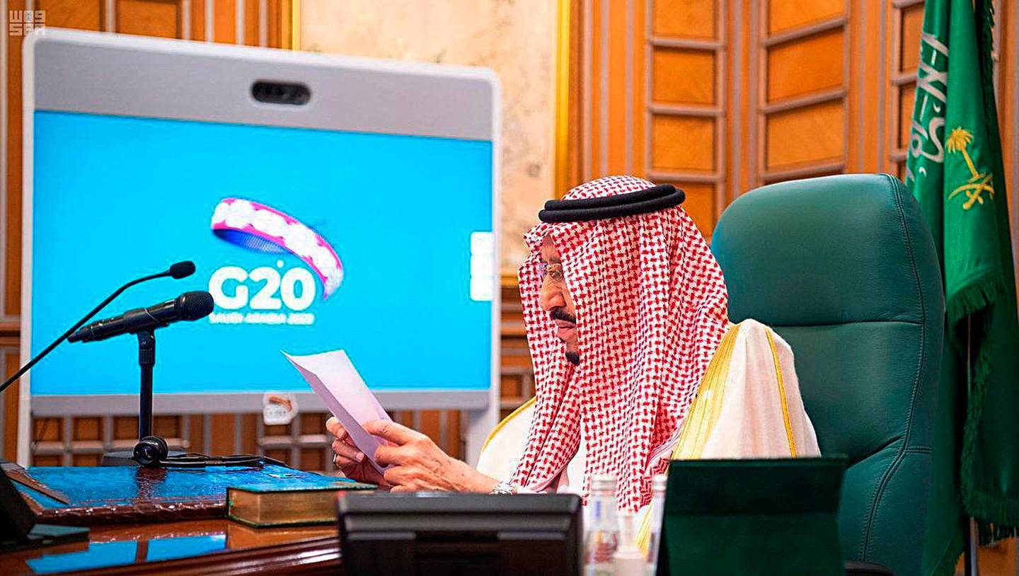 FILE - In this March 26, 2020, file photo released by Saudi Press Agency, SPA, Saudi King Salman, chairs a video call of world leaders from the Group of 20 and other international bodies and organizations, from his office in Riyadh, Saudi Arabia. The Nov. 21-22, 2020, Group of 20 summit, hosted by Saudi Arabia, will be held online this year because of the coronavirus. The pandemic has offered the G-20 an opportunity to prove how such bodies can facilitate international cooperation in crises — but has also underscored their shortcomings. (Saudi Press Agency via AP, File)