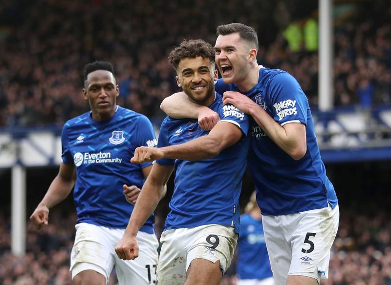 """Soccer Football - Premier League - Everton v Crystal Palace - Goodison Park, Liverpool, Britain - February 8, 2020  Everton's Dominic Calvert-Lewin celebrates scoring their third goal with Michael Keane and Yerry Mina                     Action Images via Reuters/Carl Recine  EDITORIAL USE ONLY. No use with unauthorized audio, video, data, fixture lists, club/league logos or """"live"""" services. Online in-match use limited to 75 images, no video emulation. No use in betting, games or single club/league/player publications.  Please contact your account representative for further details."""
