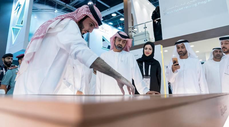 Ammar Al Nuaimi Launches Digital Applications Package at Ajman Government Suite at Gitex 15. WAM