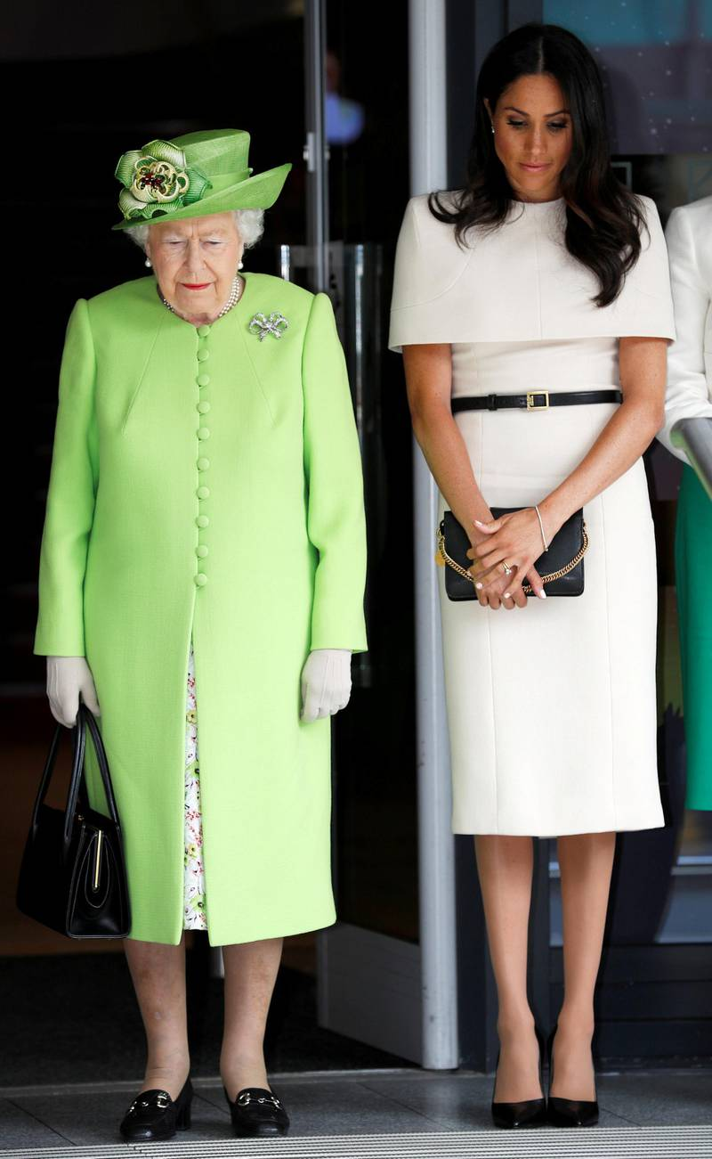 CHESTER, ENGLAND - JUNE 14:  Queen Elizabeth II and Meghan, Duchess of Sussex take a moment of silence for the victums of last year's Grenfell Tower fire as they arrive for their visit to the Storyhouse on June 14, 2018 in Chester, England. Meghan Markle married Prince Harry last month to become The Duchess of Sussex and this is her first engagement with the Queen. During the visit the pair will open a road bridge in Widnes and visit The Storyhouse and Town Hall in Chester.  (Photo by Phil Noble - WPA Pool/Getty Images)