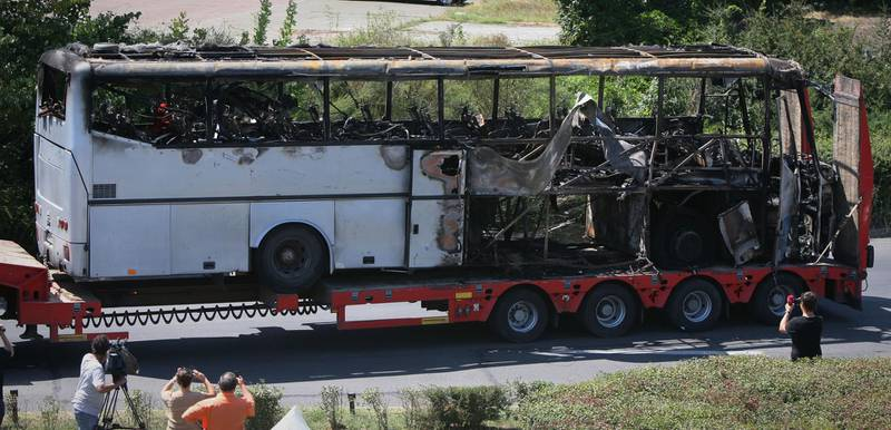 FILE - In this Thursday, July 19, 2012 file photo, a damaged bus is transported out of Burgas airport, Bulgaria, a day after a deadly suicide attack on a bus full of Israeli vacationers. Israel's prime minister said Sunday, July 22, 2012 that his country is on alert for plots to kill more of its citizens overseas, after speculation that last week's deadly bombing of a tour bus in Bulgaria was a rehearsal for a spectacular attack on Israel's Olympics team. (AP Photo/ Impact Press Group)