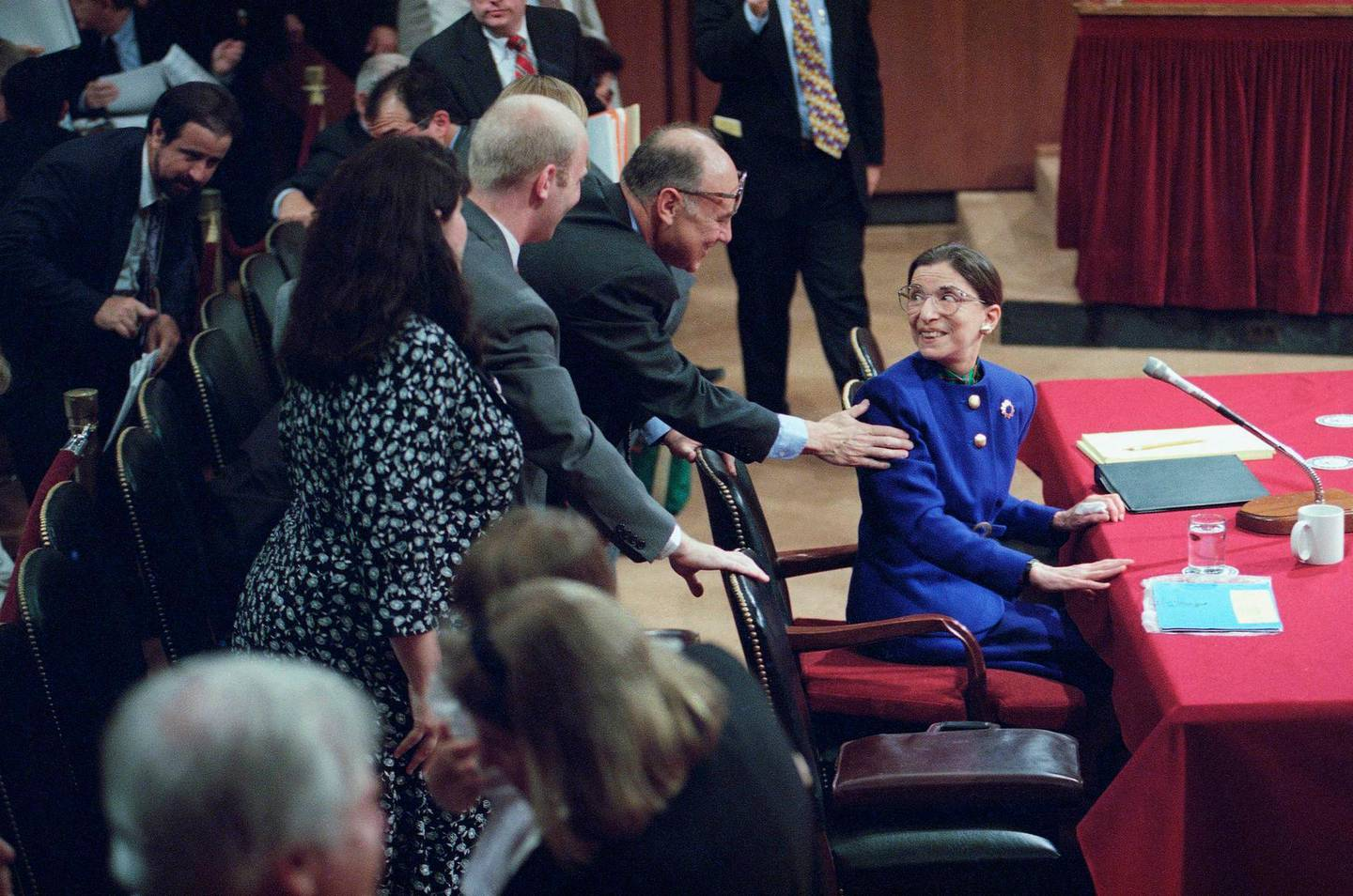 Supreme Court nominee Judge Ruth Bader Ginsburg is greeted by her husband Martin as she introduced her family during her confirmation hearing before the Senate Judiciary Committee on Capitol Hill on Tuesday, July 20, 1993 in Washington. Ginsburg's son James and wife Lisa Brauston are at left. (AP Photo/John Duricka)