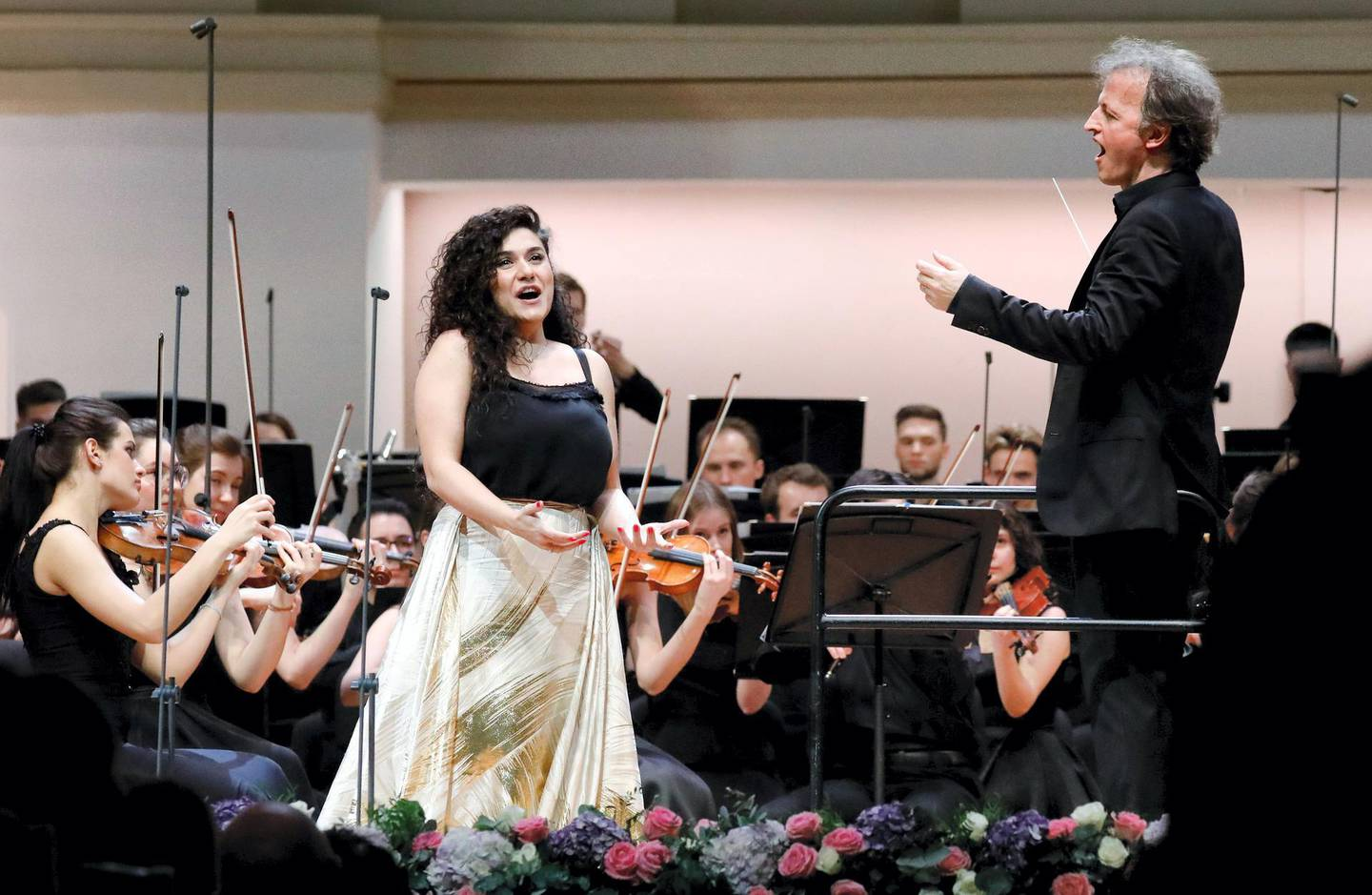 MOSCOW, RUSSIA - MARCH 8, 2020: Soprano Anna Agalatova (L) and French violinist and conductor Jean-Christophe Spinosi perform with the Russian National Youth Symphony Orchestra during a concert at Tchaikovsky Concert Hall. Artyom Geodakyan/TASS (Photo by Artyom Geodakyan\TASS via Getty Images)