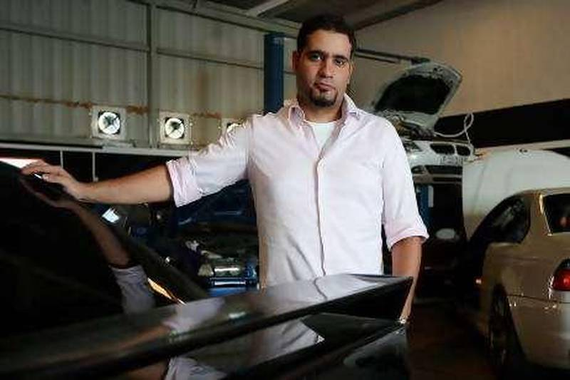 DUBAI, UNITED ARAB EMIRATES Ð Sep 15: Ayham Al Daqqa, President of the BMW club for the Middle East and the owner of Das AutoWorks at his workshop near Times Square Mall in Dubai. (Pawan Singh / The National) For Personal Finance.