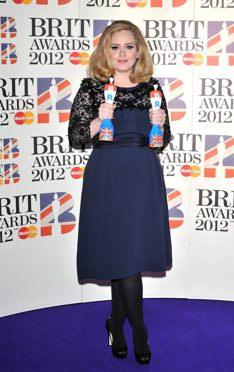 epa03115763 British singer Adele poses with her Best Album and Best British Female awards at the 2012 BRIT Awards held at the O2 Arena in London, Britain, 21 February 2012.  EPA/DANIEL DEME