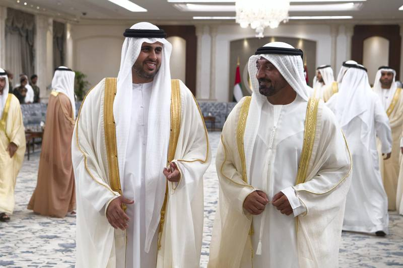 ABU DHABI, UNITED ARAB EMIRATES - June 15, 2018: HH Sheikh Theyab bin Mohamed bin Zayed Al Nahyan, Chairman of the Department of Transport, and Abu Dhabi Executive Council Member (L) and HH Sheikh Ahmed bin Saeed Al Maktoum, President of the Department of Civil Aviation, CEO and Chairman of The Emirates Group, and Chairman of Dubai World (R), attend an Eid Al Fitr reception at Mushrif Palace.   ( Saeed Al Neyadi / Crown Prince Court - Abu Dhabi ) ---