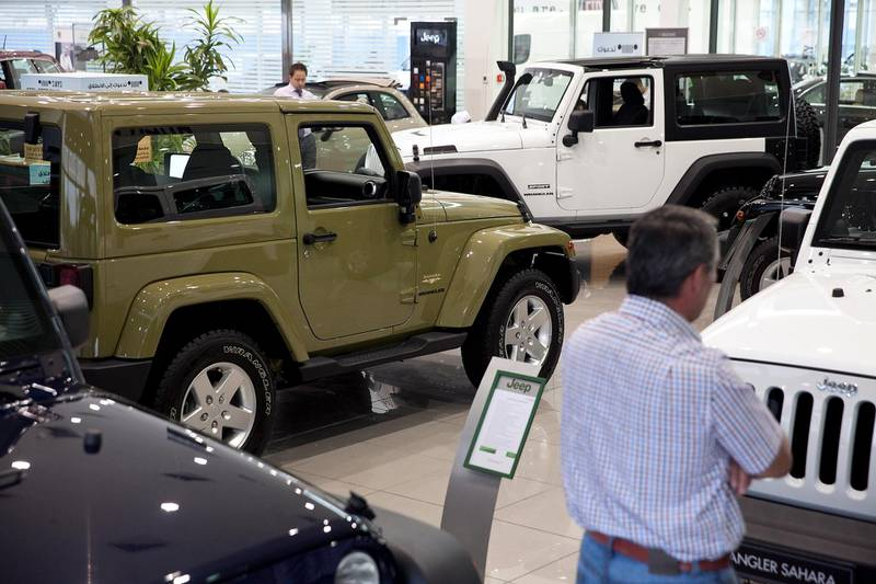 Abu Dhabi, United Arab Emirates, May 27, 2013:  Potential customers check out one of the latest models of Jeep SUVs as they shop around for a car on Monday, May 27, 2013, at the Emirates Motor Company showroom on Airport Road in Abu Dhabi. Silvia Razgova / The National