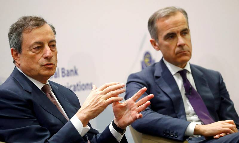 FILE PHOTO: Central Bank Governors Mario Draghi of the European Central Bank (ECB) and Mark Carney of the Bank of England attend ECB's Central Bank Communications Conference in Frankfurt, Germany, November 14, 2017.  REUTERS/Kai Pfaffenbach/File Photo