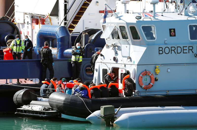 Migrants are brought into Dover Harbour by Border Force officers, in Dover, Britain March 25, 2021. REUTERS/Paul Childs
