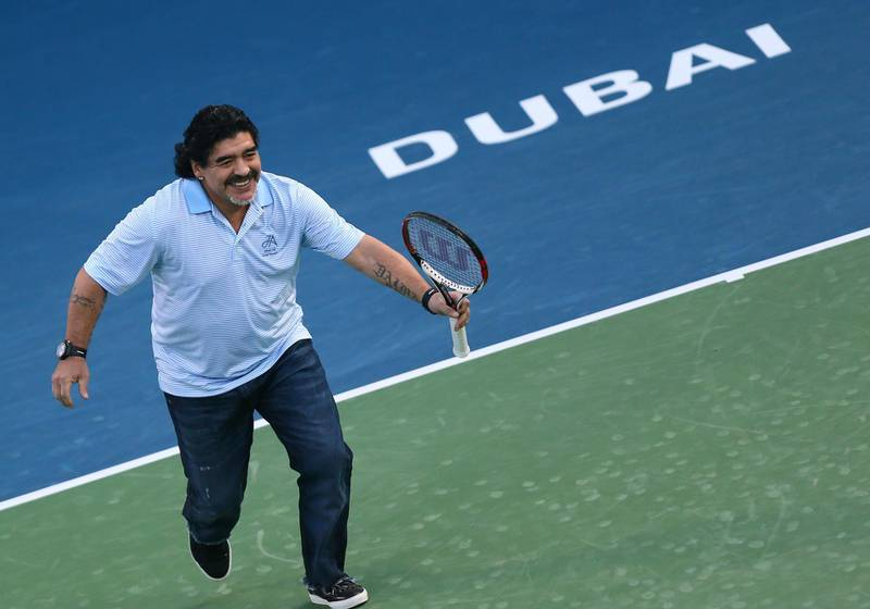 Argentina's football legend Diego Maradona runs as he plays against his compatriot tennis player Juan Martin Del Potro during a show following Del Potro's victory against India's Somdev Devvarman during the ATP Dubai Open tennis tournament in the Gulf emirate on February 27, 2013.  AFP PHOTO/MARWAN NAAMANI (Photo by MARWAN NAAMANI / AFP)
