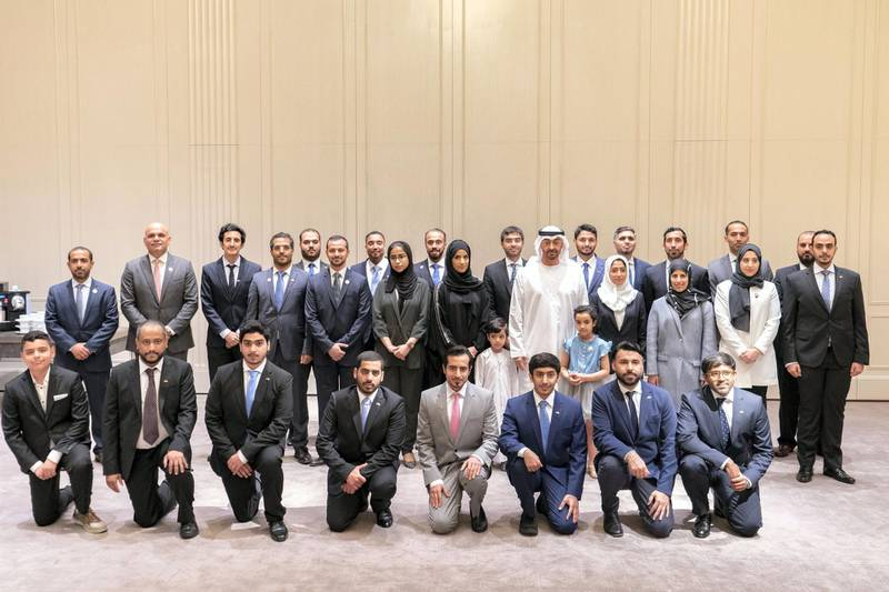 BERLIN, GERMANY - June 12, 2019: HH Sheikh Mohamed bin Zayed Al Nahyan, Crown Prince of Abu Dhabi and Deputy Supreme Commander of the UAE Armed Forces (2nd row 5th R), stands for a photograph with Emirati students who are studying in Germany.  ( Rashed Al Mansoori / Ministry of Presidential Affairs ) ---
