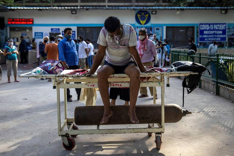 A patient suffering from the coronavirus disease (COVID-19) waits to get admitted outside the casualty ward at Guru Teg Bahadur hospital, amidst the spread of the disease in New Delhi, India, April 23, 2021. REUTERS/Danish Siddiqui