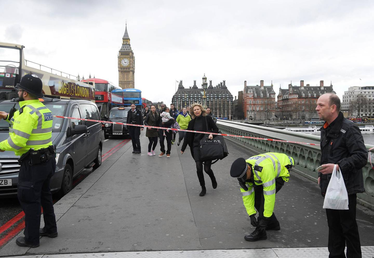 A woman ducks under a police tape after an incident on Westminster Bridge in London, March 22, 2017.  REUTERS/Toby Melville  - LR1ED3M16TMRJ