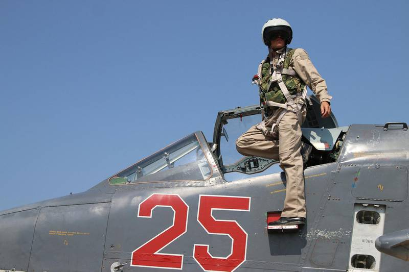 A picture taken on October 3, 2015 shows a Russian army pilot leaving the cockpit of a Russian Sukhoi Su-25 ground attack aircraft at the Hmeimim airbase in the Syrian province of Latakia. AFP PHOTO / KOMSOMOLSKAYA PRAVDA / ALEXANDER KOTS*RUSSIA OUT* (Photo by ALEXANDER KOTS / KOMSOMOLSKAYA PRAVDA / AFP) / Russia OUT