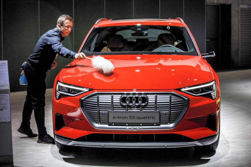 BERLIN, GERMANY - MAY 14: A staff member cleans an Audi e.tron 55 Quattro during the Volkswagen AG company's annual shareholders' meeting on May 14, 2019 in Berlin, Germany. Volkswagen is still grappling with the consequences of its diesel emissions scandal, which the company said has cost it EUR 30 billion so far. Proxy advisory groups are urging shareholders to vote against the continuation of the current Volkswagen governing board. (Photo by Carsten Koall/Getty Images)