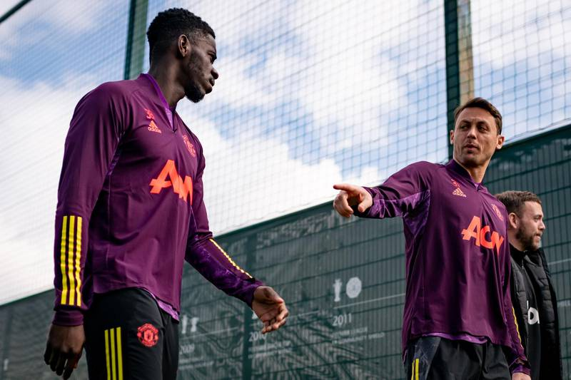 MANCHESTER, ENGLAND - APRIL 14: Axel Tuanzebe and Nemanja Matic of Manchester United in action during a first team training session at Aon Training Complex on April 14, 2021 in Manchester, England. (Photo by Ash Donelon/Manchester United via Getty Images)