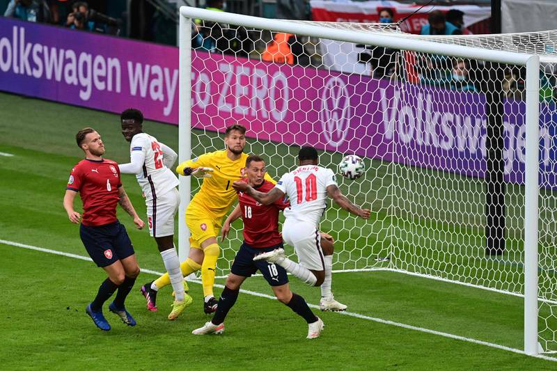 England's forward Raheem Sterling (R) scores the opening goal during the UEFA EURO 2020 Group D football match between Czech Republic and England at Wembley Stadium in London on June 22, 2021. / AFP / POOL / NEIL HALL