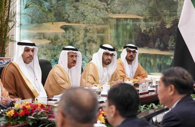 BEIJING, CHINA - July 22, 2019: (L-R) HE Khaldoon Khalifa Al Mubarak, CEO and Managing Director Mubadala, Chairman of the Abu Dhabi Executive Affairs Authority and Abu Dhabi Executive Council Member, HE Sultan bin Saeed Al Mansouri, UAE Minister of Economy, HE Dr Sultan Ahmed Al Jaber, UAE Minister of State, Chairman of Masdar and CEO of ADNOC Group and HE Hussain Ibrahim Al Hammadi, UAE Minister of Education, attend a meeting with HE Li Keqiang, Premier of the State Council of China (not shown), at the Great Hall of the People.  ( Rashed Al Mansoori / Ministry of Presidential Affairs ) ---