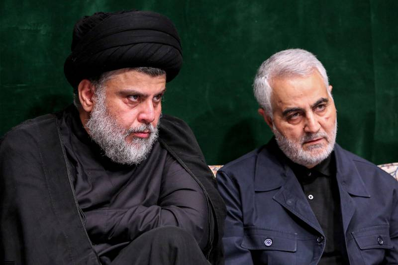 """A handout picture provided by the office of Iran's Supreme Leader Ayatollah Ali Khamenei on September 10, 2019 shows Iraqi Shiite cleric, politician, and militia leader Muqtada al-Sadr (L) sitting alongside Qasem Soleimani, Iranian Revolutionary Guards Corps (IRGC) Major General and commander of the Quds Force, during a ceremony commemorating Ashura in the capital Tehran. - Ashura is commemorated by Shiite Muslims worldwide and marks the climax of mourning rituals in the Islamic month of Muharram for the 7th century killing of Imam Hussein, the grandson of Prophet Mohammed, in the Battle of Karbala in 680 AD. (Photo by - / KHAMENEI.IR / AFP) / === RESTRICTED TO EDITORIAL USE - MANDATORY CREDIT """"AFP PHOTO / HO / KHAMENEI.IR"""" - NO MARKETING NO ADVERTISING CAMPAIGNS - DISTRIBUTED AS A SERVICE TO CLIENTS ==="""
