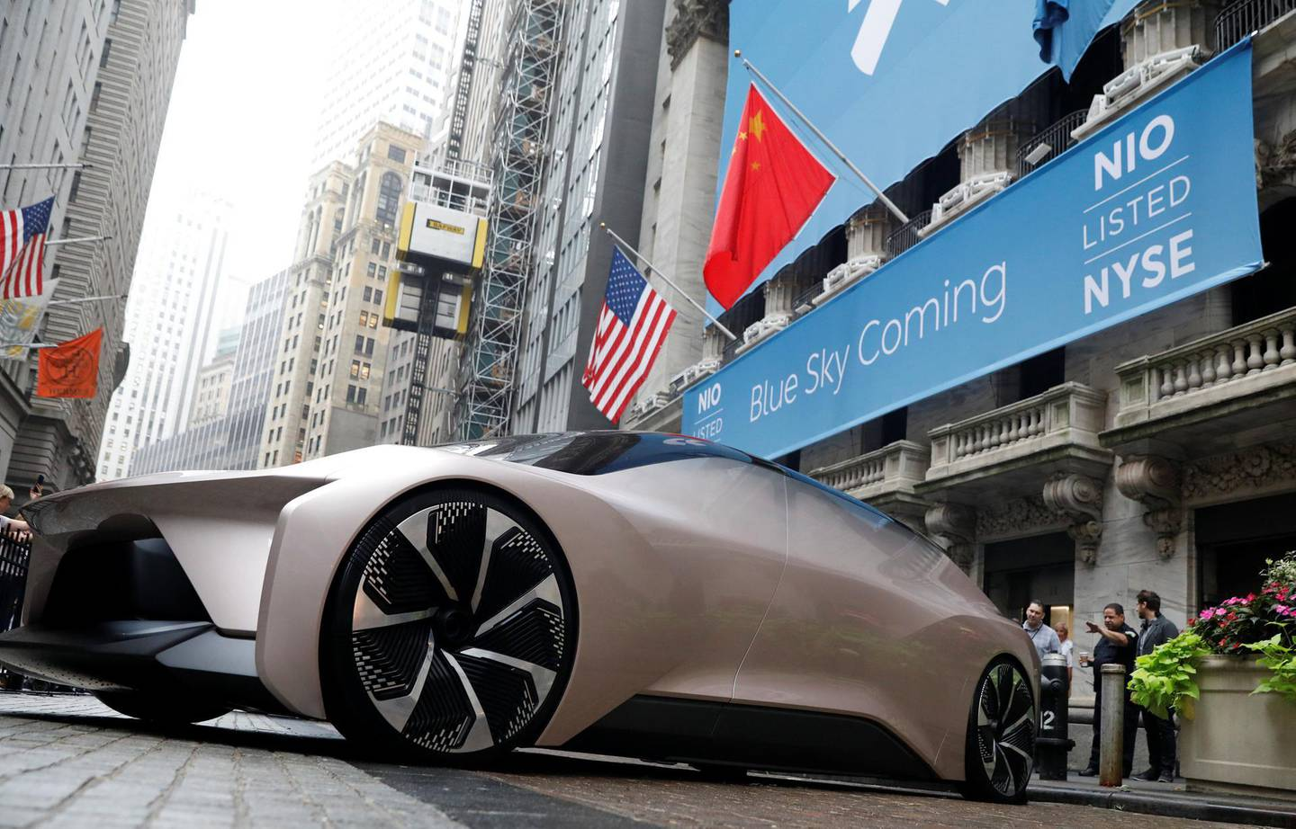 Chinese electric vehicle start-up Nio Inc. vehicle is parked in front of the New York Stock Exchange (NYSE) to celebrate the company's initial public offering (IPO) in New York, U.S., September 12, 2018.  REUTERS/Brendan McDermid