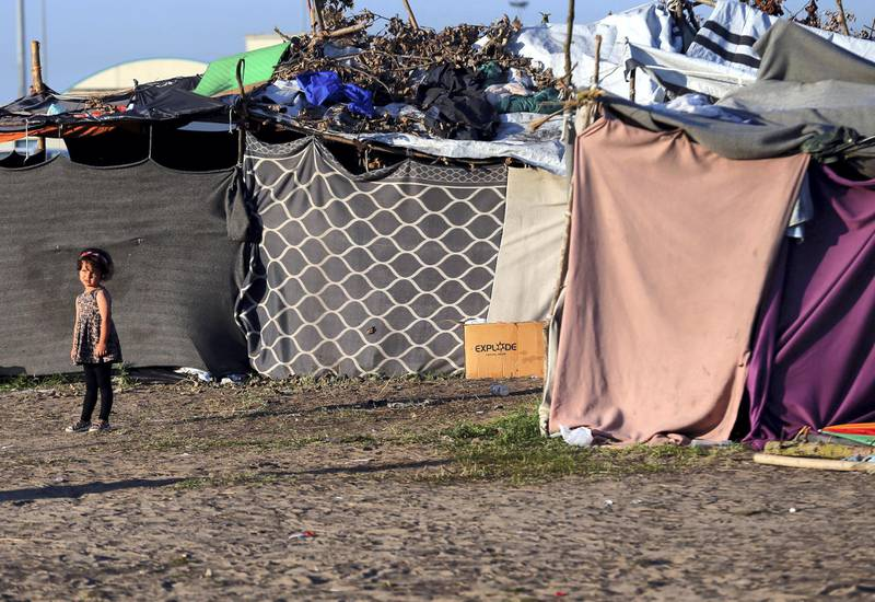 A refugee child stands outside her tent on the Hungary-Serbia border, in a camp outside a transit zone set up by Hungarian authorities to filter refugees at Roszke, Hungary, September 2, 2016. Picture taken on September 2, 2016. To match Analysis EUROPE-MIGRANTS/HUNGARY-REFERENDUM  REUTERS/Laszlo Balogh  - S1BEUBYZPOAA