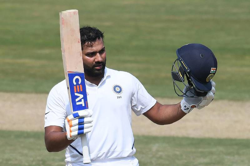 Indian cricketer Rohit Sharma raises his bat after scoring a century (100 runs) during the first day's play of the first Test match between India and South Africa at the Dr. Y.S. Rajasekhara Reddy ACA-VDCA Cricket Stadium in Visakhapatnam on October 2, 2019. ----IMAGE RESTRICTED TO EDITORIAL USE - STRICTLY NO COMMERCIAL USE----- / GETTYOUT  / AFP / NOAH SEELAM / ----IMAGE RESTRICTED TO EDITORIAL USE - STRICTLY NO COMMERCIAL USE----- / GETTYOUT