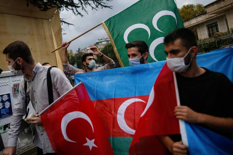 Youths from the Turkey Youth Foundation organisation chant slogans during a protest supporting Azerbaijan in front of Azerbaijan's consulate in Istanbul, Tuesday, Sept. 29, 2020. Armenian and Azerbaijani forces accused each other of attacks on their territory Tuesday, as fighting over the separatist region of Nagorno-Karabakh continued for a third straight day following the reigniting of a decades-old conflict. (AP Photo/Emrah Gurel)