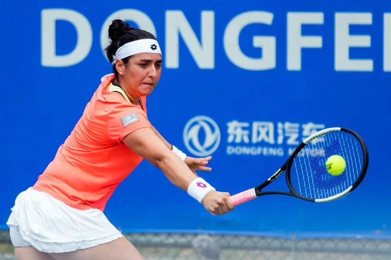 WUHAN, CHINA - SEPTEMBER 24: Ons Jabeur of Turkey returns a shot in the second round match against Elena Rybakina of Kazakhstan on Day three of 2019 Dongfeng Motor Wuhan Open at Optics Valley International Tennis Center on September 24, 2019 in Wuhan, Hubei Province of China. (Photo by VCG/VCG via Getty Images)