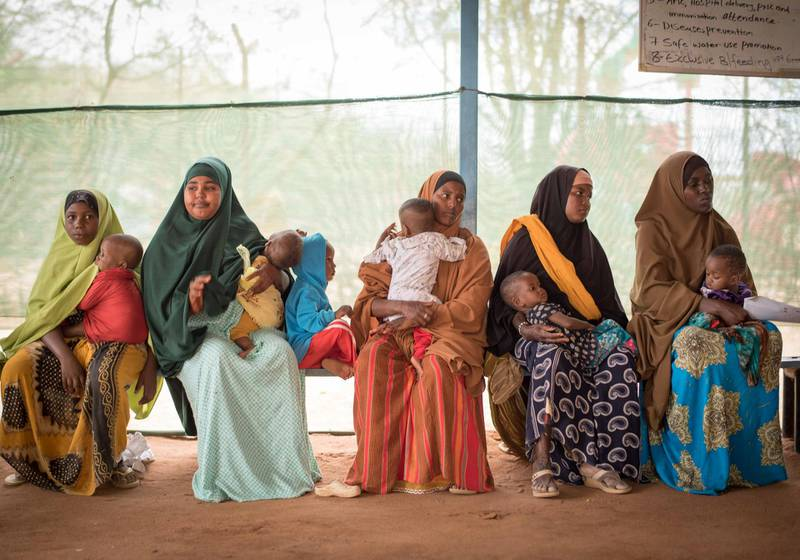 Mothers wait at an MSF health post in Dagahaley to get a nutrition check-up for their children.