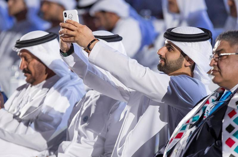 ABU DHABI, UNITED ARAB EMIRATES - March 17, 2018: HH Sheikh Mansour bin Mohamed bin Rashid Al Maktoum (2nd R), attends the opening ceremony of the Special Olympics IX MENA Games Abu Dhabi 2018, at the Abu Dhabi National Exhibition Centre (ADNEC).( Ryan Carter for the Crown Prince Court - Abu Dhabi )