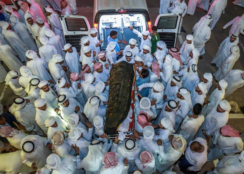 Abu Dhabi, U.A.E., October 2, 2018.    Family of Ali Al Katheeri, fire victims at a Baniyas fire being taken to the Baniyas Graveyrd  after prayers at the mosque.Victor Besa/ The NationalSection:  NAReporter:  John Dennehy