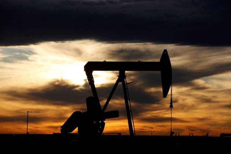 FILE PHOTO: The sun sets behind a crude oil pump jack on a drill pad in the Permian Basin in Loving County, Texas, U.S. November 24, 2019. .  REUTERS/Angus Mordant/File Photo