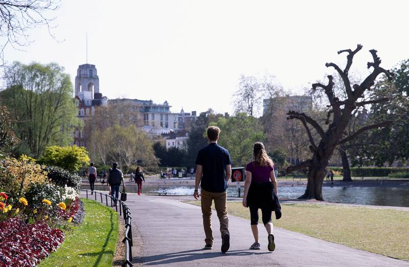 LONDON, ENGLAND - APRIL 10: A couple walking in Regents Park, Good Friday on April 10, 2020 in London. There have been around 70,000 reported cases of the COVID-19 coronavirus in the United Kingdom and 8,000 deaths. The country is in its third week of lockdown measures aimed at slowing the spread of the virus. (Photo by Jo Hale/Getty Images)
