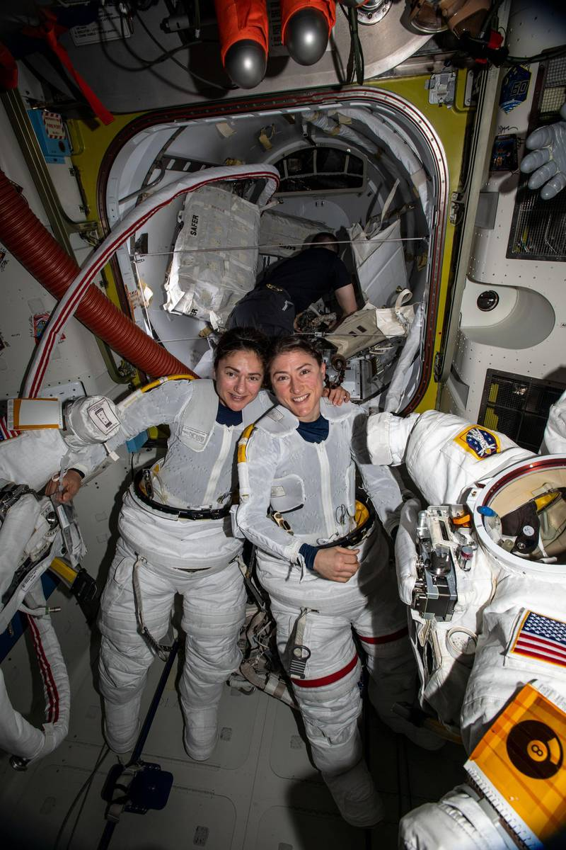 NASA astronauts Jessica Meir (left) and Christina Koch (right) put on their spacesuits as they prepare to leave the hatch of the International Space Station and begin the historical first-ever all-female spacewalk. The two ventured outside the International Space Station on Friday, Oct. 18, to replace faulty equipment on the station's exterior. The astronauts replaced a faulty battery charge/discharge unit (BCDU) that failed to activate following the Oct. 11 installation of new lithium-ion batteries on the space station's exterior structure. The BCDUs regulate the amount of charge put into the batteries that collect energy from the station's solar arrays to power station systems during periods when the station orbits during nighttime passes around Earth. Though the BCDU failure has not impacted station operations or crew safety, it does prevent the new batteries from providing increased station power. Courtesy NASA
