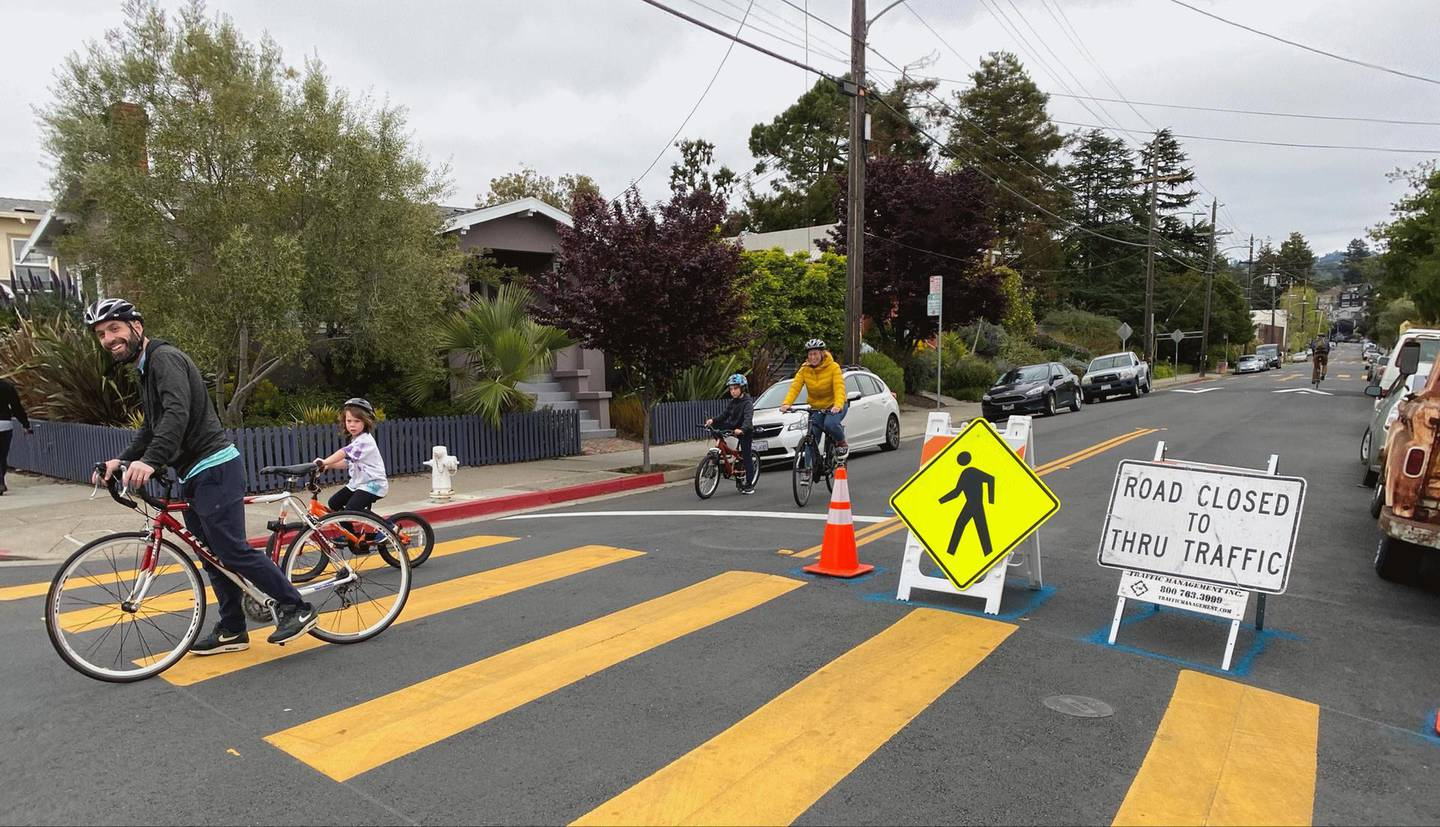 Family biking on Oakland Slow Street at 42nd and Shafter. Courtesy City of Oakland