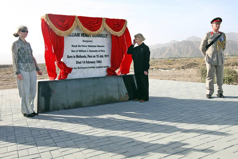 """United Arab Emirates- Fujairah - January 27, 2010:  NATIONAL: A memorial to Sergeant William Donnelly (cq-al), a member of Britain's Royal Air Force who was killed when his plane crashed in Sayh Dhadnah in the emirate of Fujairah during World War II, is dedicated by his great niece Lesley Botten (cq-al), of Kinross, Scotland, left, and his niece (Lesley's mother) June Botten (cq-al), of Reading, England, center, as well as a member of the British Royal Air Force  on Wednesday, January 27, 2010 in Fujairah . """"When I first read the report of how the accident first happened,"""" said Lesley, who is the family history buff. """"It brings it very much to life. The pilot noticed a small problem. There was an oil leak. He turned around. They lost a propeller. You start to think about what was going on in their minds."""" Amy Leang/The National *** Local Caption ***  amy012710mem01 copy.jpg"""
