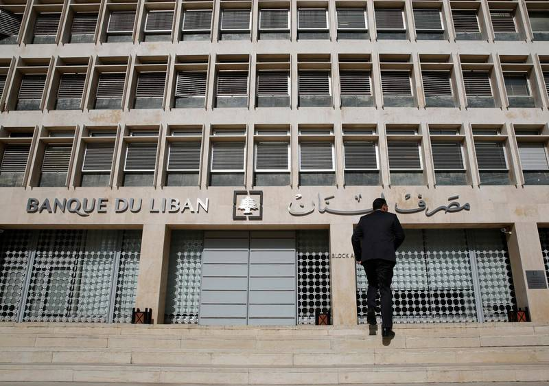 A man heads to the Lebanese central bank, in Beirut, Lebanon, Tuesday, Jan. 22, 2019. Lebanon's finance minister says a report by Moody's Investors Service that downgraded the country's long-term investment ratings reflect the need for quickly forming a new government and implement financial reform. Ali Hassan Khalil's tweet on Tuesday came hours after Moody's downgraded the Lebanon's issuer ratings to Caa1 from B3. (AP Photo/Hussein Malla)