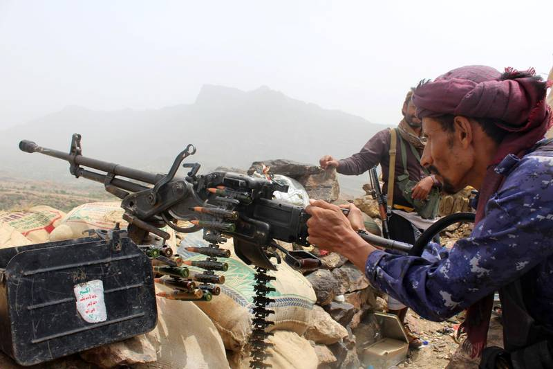 A Yemeni pro-government fighter fires a heavy machine gun as Emirati supported forces take over Huthi bases on the frontline of Kirsh between the province of Taez and Lahj, southwestern Yemen, on July 1, 2018. The United Arab Emirates on Sunday announced it had halted the offensive it is backing against Huthi rebels in Yemen's port city of Hodeida to give a chance to UN diplomatic efforts.  / AFP / Saleh Al-OBEIDI