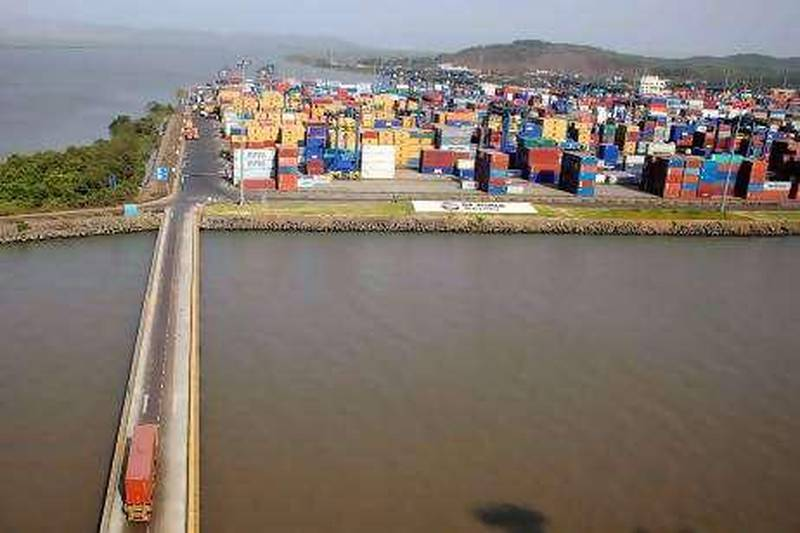An aerial view shows shipping containers stacked at DP World Ltd.'s Nhava Sheva port in Navi Mumbai, India, on Monday, May 17, 2010. DP World Ltd. said as much as $1 billion may be invested in the first Indian port able to handle the largest container ships as the company tries to challenge Colombo's grip on India's maritime trade with Europe and China. Photographer: Adeel Halim/Bloomberg   *** Local Caption ***  676133.jpg