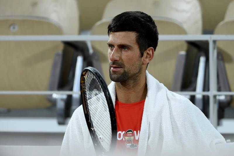 PARIS, FRANCE - SEPTEMBER 25: Novak Djokovic of Serbia looks on during a training session at Roland Garros  on September 25, 2020 in Paris, France. (Photo by Martin Sidorjak/Getty Images)