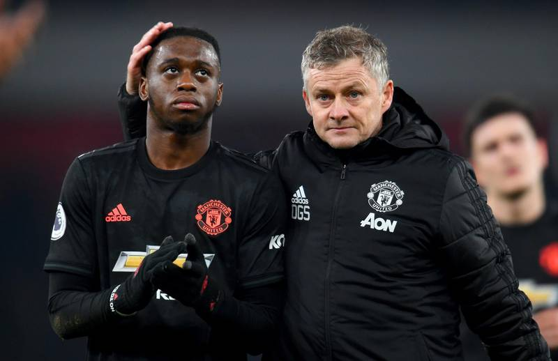 LONDON, ENGLAND - JANUARY 01: Ole Gunnar Solskjaer, Manager of Manchester United speaks to Aaron Wan-Bissaka of Manchester United after the Premier League match between Arsenal FC and Manchester United at Emirates Stadium on January 01, 2020 in London, United Kingdom. (Photo by Clive Mason/Getty Images)