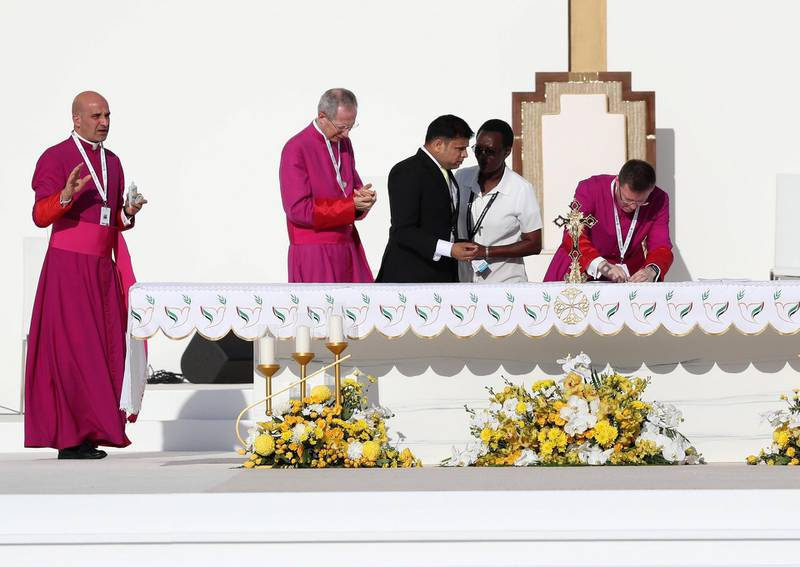 Abu Dhabi, United Arab Emirates - February 05, 2019: People get ready for the mass. Pope Francis takes a large public mass to mark his land mark visit to the UAE. Tuesday the 5th of February 2019 at Zayed Sports city stadium, Abu Dhabi. Chris Whiteoak / The National