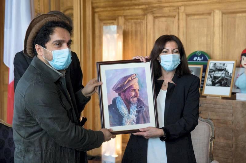 Paris paid homage to late Afghan commander Ahmad Shah Massoud. Paris Mayor Anne Hidalgo and Ahmad Massoud hold an image of late Afghan commander Ahmad Shah Massoud Courtesy Office of Paris Mayor