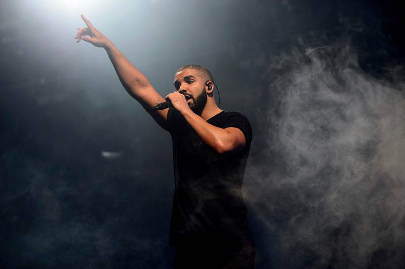 """FILE - In this June 27, 2015 file photo, Canadian singer Drake performs on the main stage at Wireless festival in Finsbury Park, London. Drake's """"Scorpion,"""" the highly anticipated, 25-track album by pop music's No. 1 player, was released Friday. (Photo by Jonathan Short/Invision/AP, File)"""